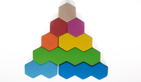 Colourful pyramid made out of stacked, hexagon blocks